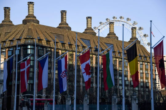 Flags of NATO members fly in Parliament Square, ahead of the summit held on Dec. 3 and 4 in London, Monday, Dec. 2, 2019.