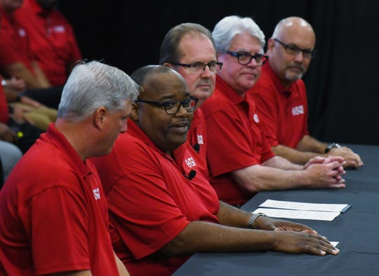 Acting UAW President Rory Gamble, second from left, and former President Gary Jones, third from left. during the first day of contract talks with Ford Motor Co.