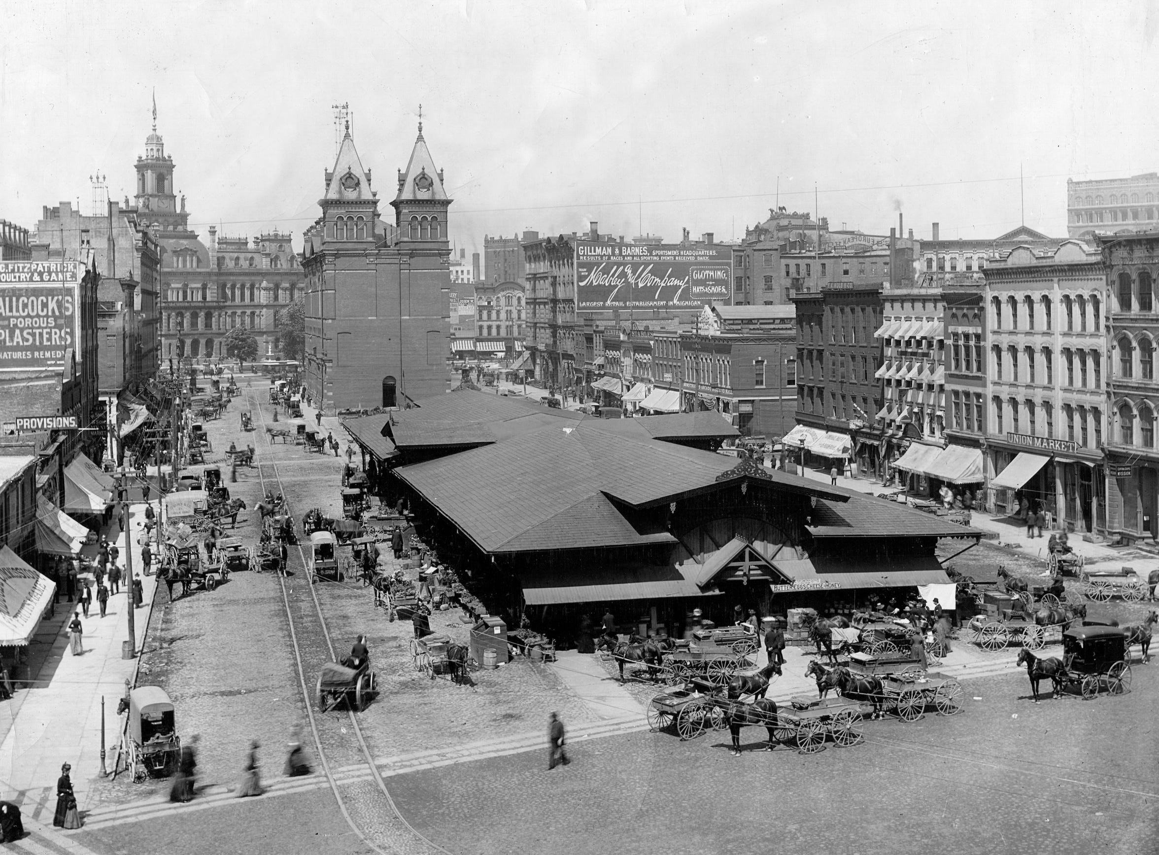 The vegetable sheds at Detroit's Central Market in Cadillac Square are bustling in this photo from the 19th century.  Behind them was the market building, where meat was sold.