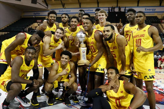 Maryland poses with the Orlando Invitational trophy after defeating Marquette on Sunday.