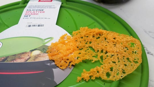 Cheese wafer microwaved on a silicone splatter guard at Capers Emporium in New Harmony.