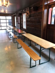 Inside 18 Hands Ale Haus, customers will find traditional German beer hall seating.