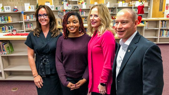 """From left, state Sen. Lizbeth Benacquisto, R-Fort Myers; kindergarten teacher Cammiel """"Ms. Camm"""" Canady; Angela Pruitt, the chief of human resources for Lee County schools; and state Rep. Spencer Roach, R-Fort Myers, after a news conference. Canady, the first recipient of the district's """"Grow Your Own Teacher Scholarship Program"""" to reach the classroom, spoke at the news conference announcing the expansion of the scholarship with state funds Monday, Dec. 2, 2019."""