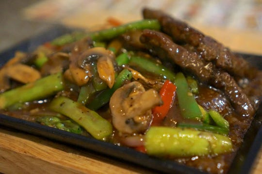 Beef short ribs are tender, with just the right ratio of fat, sizzling in a bold black pepper sauce at Ginger Bistro.