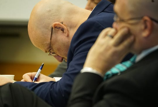 Mark Sievers writes notes during his trial Monday, Dec. 2, 2019, at the Lee County Justice Center in Fort Myers. Sievers is charged with first-degree murder and conspiracy to commit murder for the death of his wife Teresa Sievers.