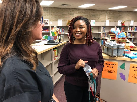 """Cammiel """"Ms. Camm"""" Canady is a kindergarten teacher at Sunshine Elementary School in Lehigh Acres. She benefited from the Lee County school district's """"Grow Your Own Teacher Scholarship Program,"""" and talks with state Sen. Lizbeth Benacquisto, R-Fort Myers after a news conference Monday, Dec. 2, 2019."""
