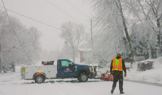 Sturgeon Bay safety crews clean up fallen trees and power lines after the weekend's winter storms that caused power outages throughout Door County.