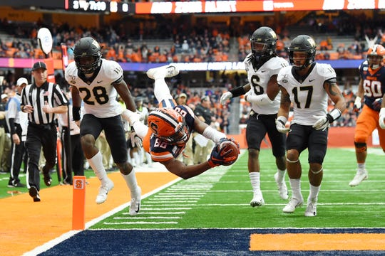 Syracuse Orange wide receiver Taj Harris (80) dives for the end zone in front of Wake Forest Demon Deacons defensive back Zion Keith (28) during the first quarter at the Carrier Dome, Nov 30, 2019. Harris would be ruled out of bounds prior to the touchdown.