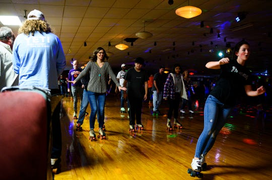 Roller skaters during Old School Skate Night at Roller Sports Skating Rink in Taylors Sunday, Dec. 1, 2019.