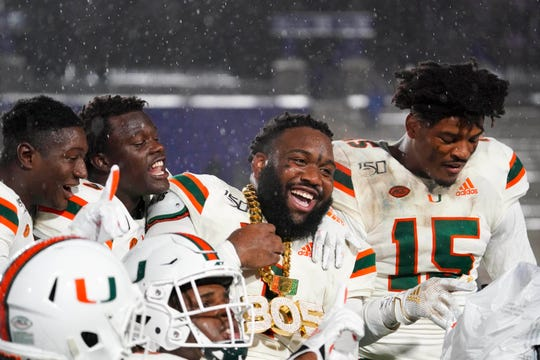 Miami Hurricanes players celebrate during the second half against the Duke Blue Devils at Wallace Wade Stadium, Nov 30, 2019.