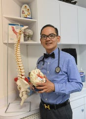 Dr. Ramel Carlos, a board certified neurologist, during a photo shoot at his Tamuning clinic on Dec. 2, 2019.