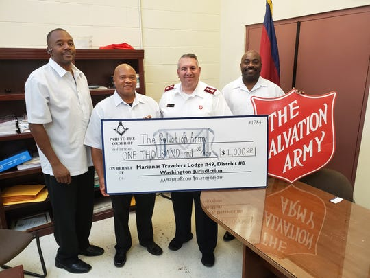 Members of the Prince Hall Masonic Family, District Eight, donated $1,000 to support the Salvation Army's 23rd Thanksgiving dinner to help feed Guam's homeless and indigent population. From left: RW Gregory Nicholson, WM Kevin Manns, Major Tom Stambaugh and SW Clifton Krisel.