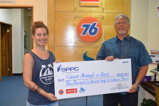 South Pacific Petroleum Corporation presented a check for $3,646.38 to Guam Animals In Need on Nov. 11. The proceeds were raised through donation jars which were placed at all 76/Circle K stores. Pictured from left: Alison Hadley, executive director of G.A.I.N. and Mark J. Sablan, SPPC'S vice-president Business Development.