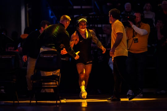 Iowa's Pat Lugo is seeking his 100th career victory when the top-ranked Hawkeyes host No. 2 Penn State on Friday at Carver-Hawkeye Arena in Iowa City.
