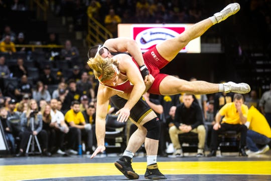 Iowa's Tony Cassioppi, left, wrestles Wisconsin's Trent Hillger at 285 pounds during a NCAA Big Ten Conference wrestling dual, Sunday, Dec. 1, 2019, at Carver-Hawkeye Arena in Iowa City, Iowa.