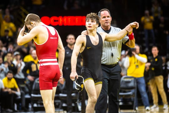 Iowa's Austin DeSanto has his hand raised after defeating Wisconsin's Seth Gross at 133 pounds during a NCAA Big Ten Conference wrestling dual, Sunday, Dec. 1, 2019, at Carver-Hawkeye Arena in Iowa City, Iowa.