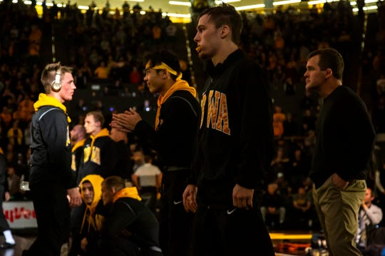 Iowa's Spencer Lee and Aaron Cashman get ready before introductions during a NCAA Big Ten Conference wrestling dual, Sunday, Dec. 1, 2019, at Carver-Hawkeye Arena in Iowa City, Iowa.