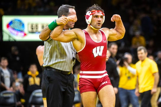 Wisconsin's Johnny Sebastian celebrates after scoring a takedown on Iowa's Cash Wilcke in the second sudden victory period at 184 pounds during a NCAA Big Ten Conference wrestling dual, Sunday, Dec. 1, 2019, at Carver-Hawkeye Arena in Iowa City, Iowa.