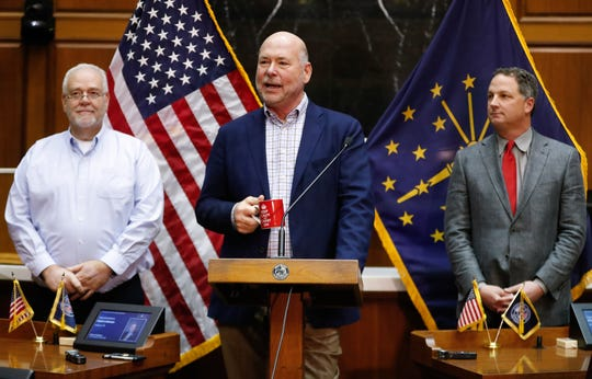 Indiana House Speaker Brian Bosma (center) announces the next speaker, Todd Huston (right) of Fishers, at the Statehouse Monday as Majority Floor Leader Matt Lehman stands with the pair.