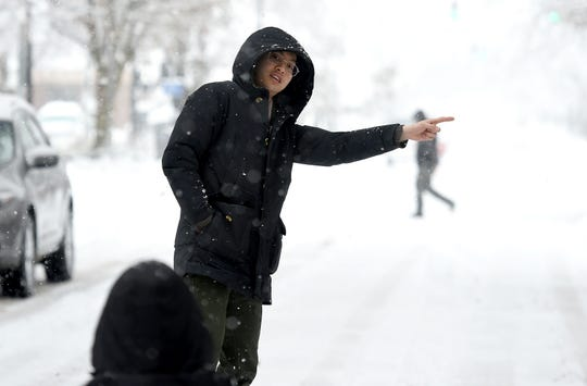 "Alice Cho and Andrew Kim, both of Ithaca, take selfies on West State St. on Monday. This is the second winter Cho has spent in Ithaca and says that while there is snow in her home country of South Korea, ""it's not as pretty as it is in Ithaca."" December 2, 2019."