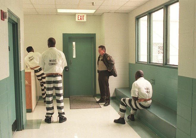 In this 1998 photo, an Issaquena County sheriff's deputy prepares to transport prisoners to medical exams from the Issaquena County Regional Correctional Facility near Mayersville.