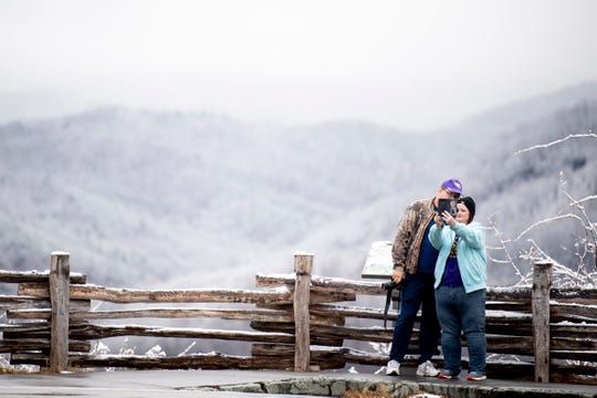Visitors take a selfie at an overlook on the Gatlinburg Bypass after an overnight snowfall in Great Smoky Mountains National Park, Tenn. on Monday, Dec. 2, 2019. 5 to 9 inches of snow were expected at elevations above 3,000 feet, and some of the highest peaks like Mount Le Conte were expecting a foot of snow. US Highway 441 and Newfound Gap Road from Gatlinburg, TN to Cherokee, NC, closed due to snow and ice, as well as Foothills Parkway East and West.