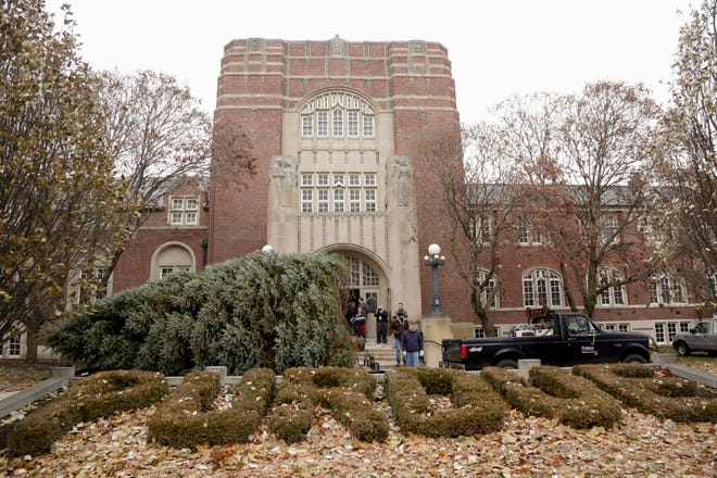 The 30-foot-tall Christmas tree arrives outside the Purdue University Memorial Union Hall, Monday, Dec. 2, 2019 in West Lafayette. The tree was donated by the Berenda family of West Lafayette.