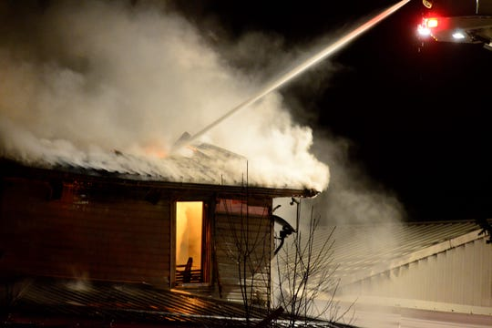 Seven fire departments battled a house fire Sunday night at 3778 Bowman Street Road, using an estimated 100,000 gallons of water.