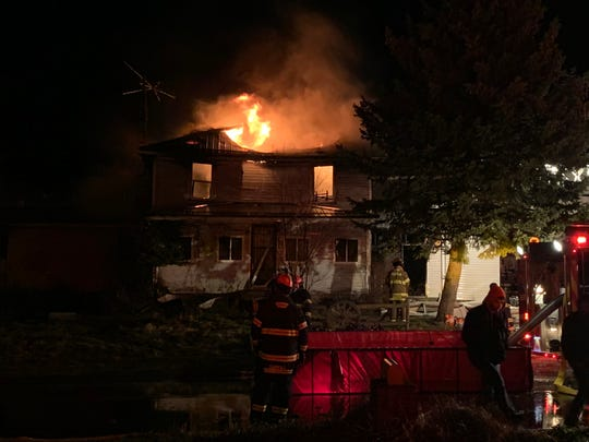 Firefighters from multiple area departments battled a house fire in the 3000 block of Bowman Street Road in Shelby on Sunday evening.