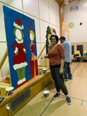 Christmas in the Village in Plymouth offers many fun activities for young and old alike. Mallory Iacobucci shows off her artistic skills.