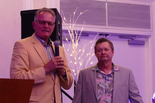 The Marco Island Area Chamber of Commerce gave the business recognition award to Alex Parker, owner of AP Builders, during the annual Winter Wonderland Christmas Celebration. In the picture, Parker speaks to the microphone at the Hilton Beach Resort and Spa on Nov. 30. Next to Parker is Rick Seigel, president of the chamber.
