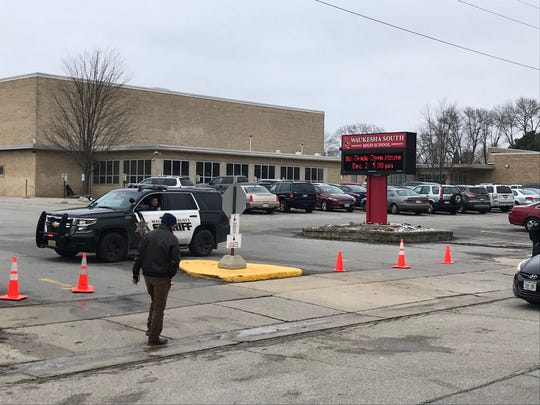 Law enforcement stages outside Waukesha South High School after reports of shots fired inside the school Monday, Dec. 2, 2019.