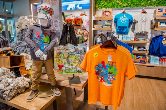 Some souvenirs for sale at the Milwaukee County Zoo's gift shop combine animal themes with pop culture themes, such as The Avengers.
