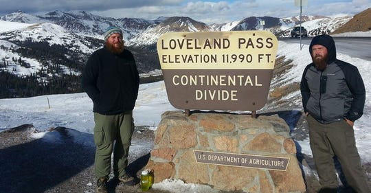 """Iraq War veterans, Anthony Anderson (left) and Tom Voss are shown at Loveland Pass in Colorado on their walk from Milwaukee to Los Angeles featured in the documentary """"After Sunrise."""""""