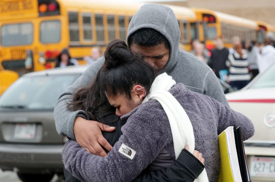Becky Galvan, center, consoles her daughter, Ashley Galvan a 15-year-old sophomore, with her father Jose Chavez outside Waukesha South High School in Waukesha on Monday, Dec. 2, 2019. A student was shot by a police officer after police say he pointed a gun at authorities.