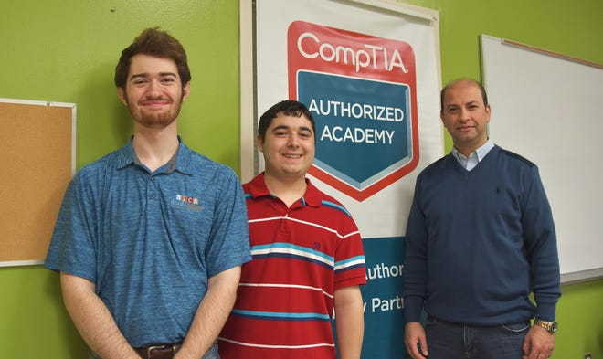 Arkansas State University-Mountain Home students (from left) Kyle Chandler, Chris Larrew, and Nuri Bilgin recently received their CompTIA A+ certification. The A+ Computer Technician program is integrated within ASU-Mountain Home's Computer Technology and Networking degree or can function as a standalone program. ASU-Mountain Home is an authorized CompTIA Academy Partner and offers the A+ Computer Technician program to help individuals prepare for the CompTIA A+ industry-recognized certification and entry-level computer career opportunities. Earning an A+ industry certification confirms a technician's ability to demonstrate various computer hardware and software skills such as installation, configuration, diagnosing, repairing, preventive maintenance, mobility, and security. The CompTIA A+ certification is an international, vendor-neutral certification recognized by major hardware and software vendors, distributors, and resellers. For more information regarding the A+ Computer Technician program or the Computer Technology and Networking degree, please contact Shawn Dennis at sdennis@asumh.edu or 870.508.6174. Registration for spring classes at ASUMH is ongoing. Classes begin Jan. 13, 2020.