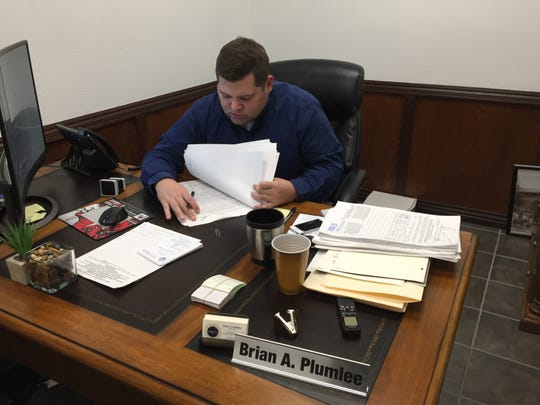 "Mountain Home Clerk Brian Plumlee reviews several pages of signatures pertaining to a petition to permit Sunday off premise alcohol sales before stamping them ""As received"" Monday morning. Supporters turned in an estimated 700 signatures, and will continue collecting more through the middle of December."