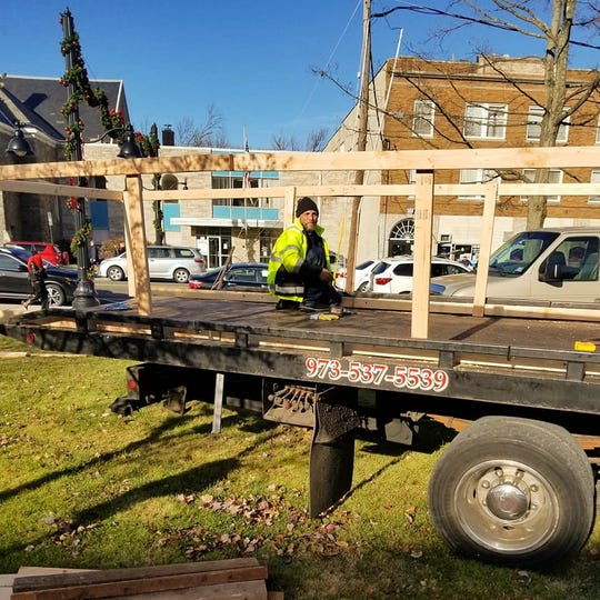 Floats are mounted on tow trucks as preparations continue for Friday's holiday parade in Dover.