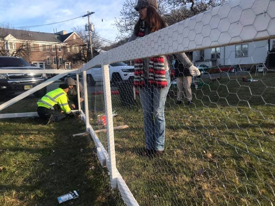 Town residents gather outside of Saint John's Episcopal Church in Dover to build floats for Friday's parade.
