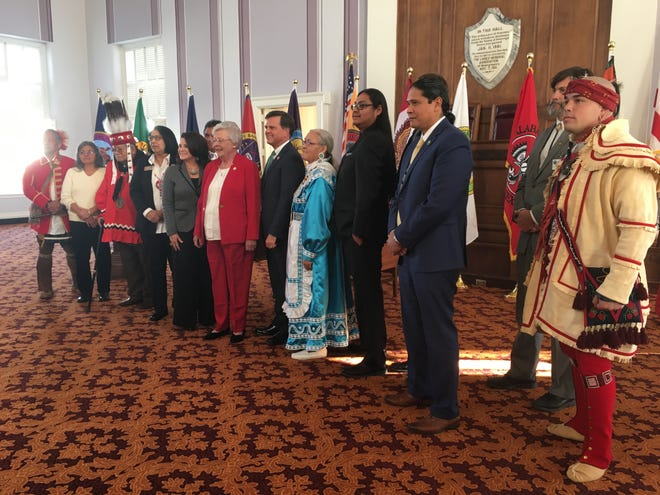 Representatives from some of the 19 federally recognized tribes that have called Alabama home appear Monday with Gov. Kay Ivey during a bicentennial event.