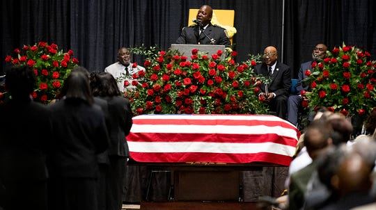 Montgomery County Sheriff Derrick Cunningham speaks during the funeral of Lowndes County Sheriff Big John Williams at Garrett Coliseum in Montgomery, Ala., on Monday, December 2, 2019.