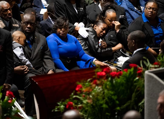Family members mourn during the funeral of Lowndes County Sheriff Big John Williams at Garrett Coliseum in Montgomery, Ala., on Monday, December 2, 2019.