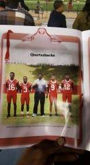 Adonica Heard holds a game program listing Kendrick as a quarterback.