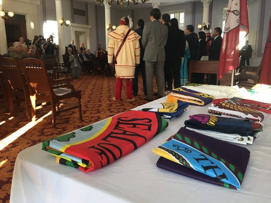Native American tribes exchange flags Monday at the Alabama Capitol building.