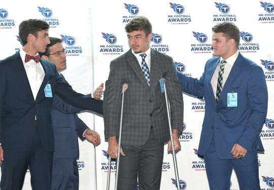 The Tennessee Titans Mr. Football winner Tim Coutras of Nollenville High is congratulated on Monday, Dec. 2, 2019 at Nissan Stadium in Nashville.