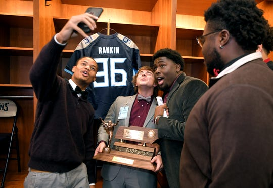 The Tennessee Titans Mr. Football Kicker of the Year Zeke Rankin, center, of Alcoa poses with friends in the Titans' locker room on Monday, Dec. 2, 2019 at Nissan Stadium in Nashville.
