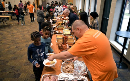 Franktown Open Hearts members and volunteers eat a Thanksgiving meal together at Christ Community Church on Wednesday, Nov. 26, 2019.