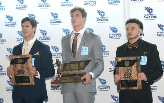 The Tennessee Titans Mr. Football Awards were presented to the top Tennessee high school football players on Monday, Dec. 2, 2019 at Nissan Stadium in Nashville. Division I, Class 1A Mr. Football winner Holden Willis of Greenback stands between finalists Hunter Ensley of Huntingdon, left, and Ronto Tipton of South Pittsburg.