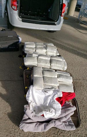 Bundles of marijuana seized by U.S. Border Patrol agents east of El Paso weighed in at 260 pounds.