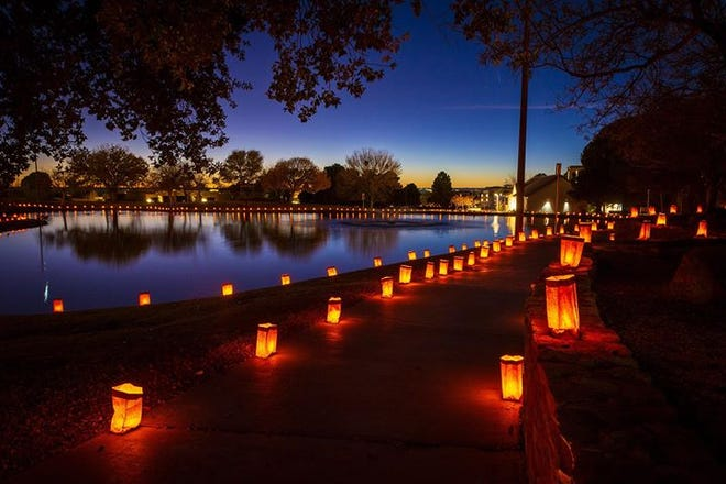 Luminarias line a pathway at New Mexico State University on Sunday, Dec. 1, part of Noche de Luminarias.